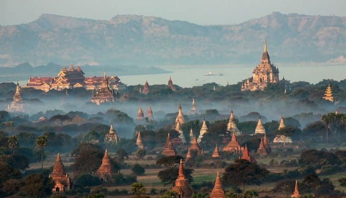 Pagodas rise above the landscape seen while cruising through Myanmar