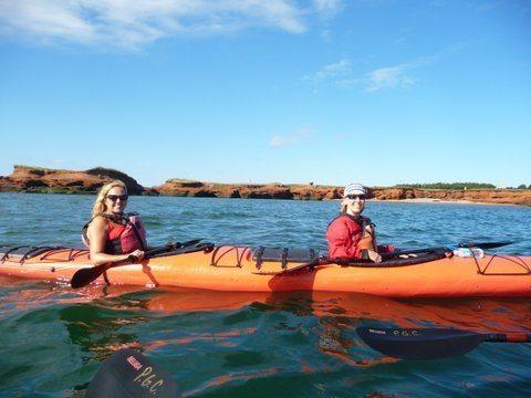 Sea kayaking in Pleasure Bay, Magdalen Islands.