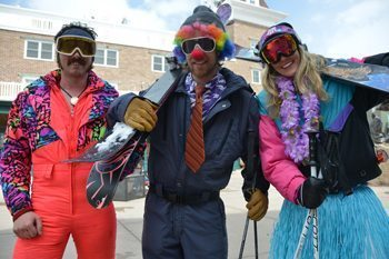 Visitors take note skiing the Wasatch Mountains on Clown Day. Skiers descend the slopes dressed to impress in grass skirts, striped neckties and red sponge noses. Sonja Stark photos.