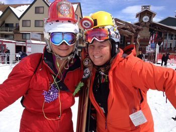 The heat is on! Two girls dressed like firemen chase a white-hot day of spring skiing in Park City, Utah.