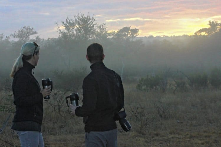 Enjoying a sunrise with friends while out in the bush