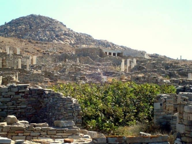 Ancient pillars and temple facades on Mount Kynthos in Delos.