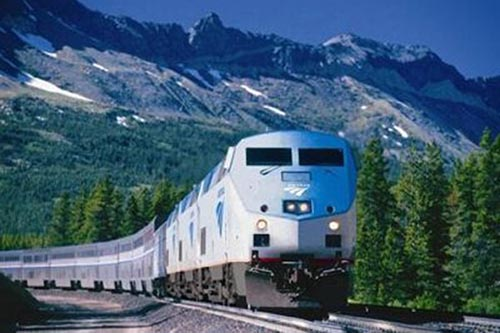 An Amtrak locomotive cruises through the American west.