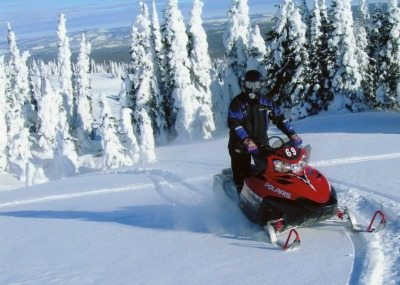 Sober travel: Snowmobiling in Big Sky, Montana. Absolute Travel photos.