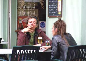 Smokers are easy to find in French cafes.