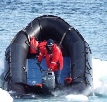 Shane Evoy, an Expedition leader, in a zodiac boat. Dennis O'Connor photo.