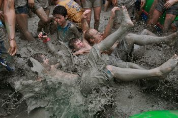 Wrestling in the mud that's trucked up from a nearby pit to the beach.