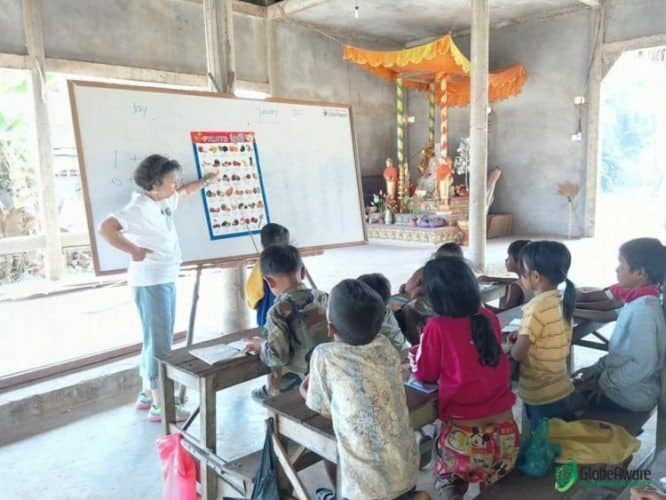 A volunteer teaches in Cambodia.