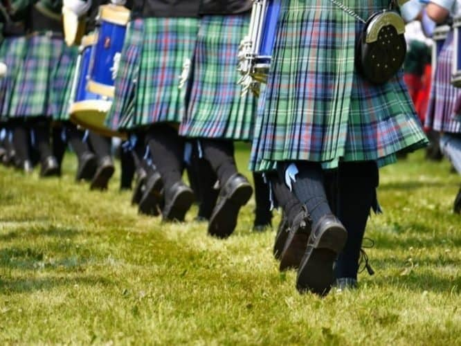 Pipe bands dressed in kilts with matching socks, and 'sporrans' or pouches worn at the waist.