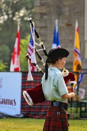 Bagpiper playing at the highland festival.