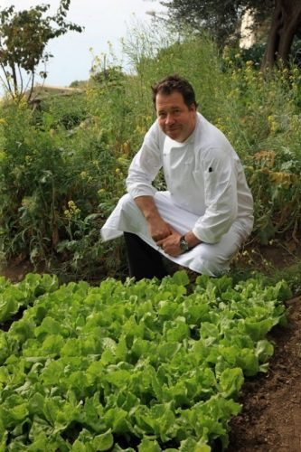 Chef Christoph Bob goes to the garden for ingredients for the evening supper at Monastero Santa Rosa. Janis Turk photo.