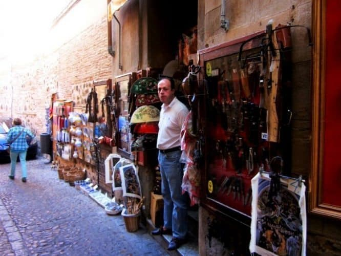 Man in Toledo selling knives and fans.
