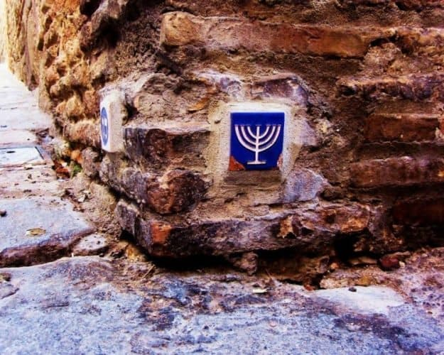 Tiles of Judaic symbols tucked in ancient cobblestones. Christopher Ludgate photos.