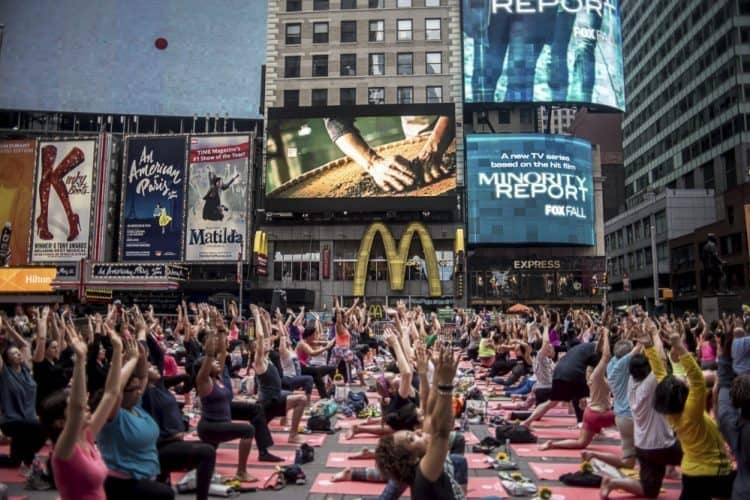 Yogis participate in the Solstice event in Times Square