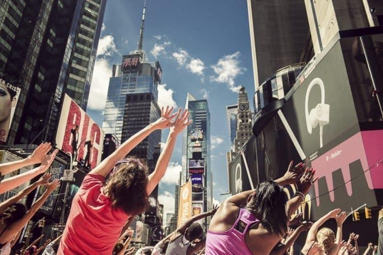 Yogis stretch, with buildings as a backdrop. Andy Castillo photos.