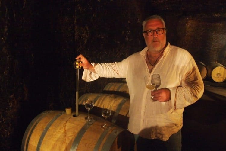 Fred Bourillon, a 3rd generation winemaker, in the large cave at Domaine Bouillion-Dorleans, where Vouvray wine is produced.
