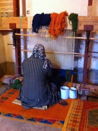 Weaving on a loom in Morocco.