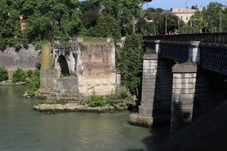 19th century Ponte Palatino next to the single-standing arch of the broken Ponte Rotto (originally Ponte Emilio), south of Isola Tiberina