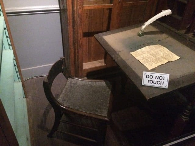 Edgar Allan Poe's writing desk and chair on display in Richmond, VA's Poe Museum.