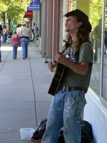 A busker on Northampton's Main Street, where more than 90 restaurants and many music clubs attract thousands of visitors.