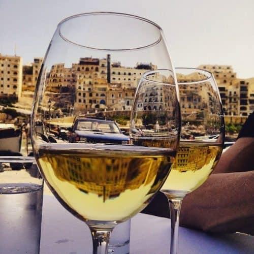 Wine glass city scene in Malta.