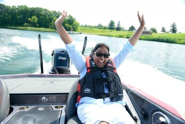Writer Vanita Salisbury going 70 mph on a bass boat after the Bassmaster's Challenge! Laura Pedrick Photography.