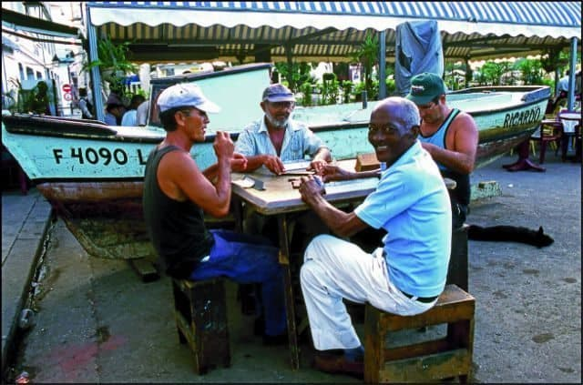 Men in San Antonio de los Banos play the Cuban version of dominoes. Talking during the game is both allowed and encouraged by the players and the people watching the game.