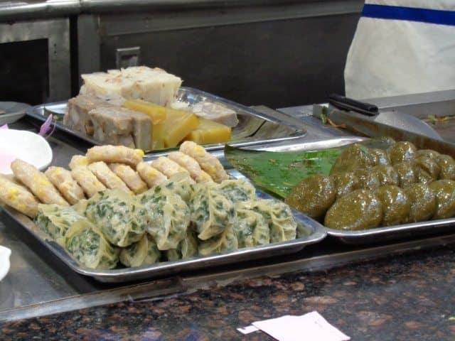 A fresh plate of jiaozi (front left), sweetcorn pancakes (back left) and green tea pancakes (right).