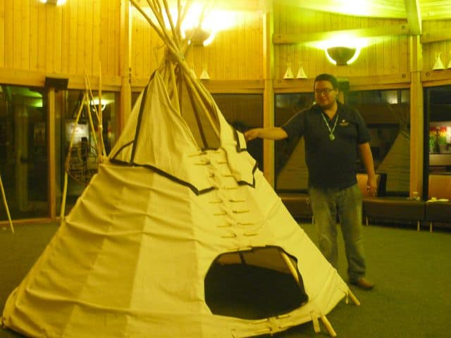 Christopher Standing shows how traditional tipis are constructed at the Wanuskewin Heritage Park.