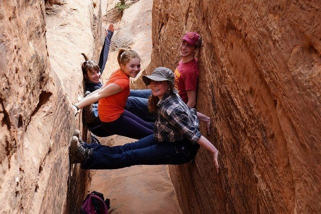 Melissa, Jack, Bridget, and Maisie Schwartz pose in a slot canyon along the Devil's Garden trail in Arches National Park