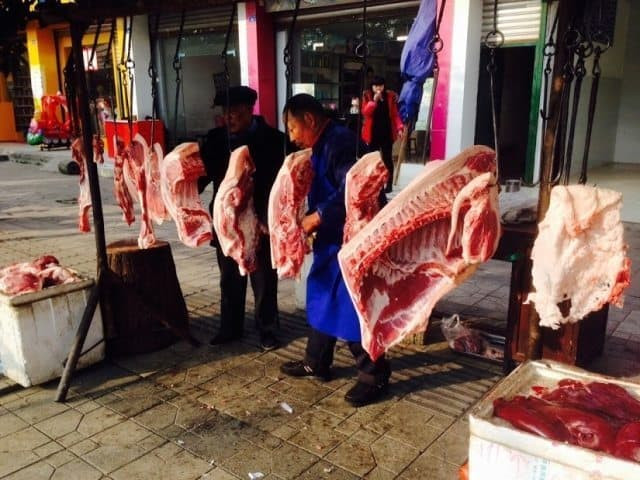 A meat market on the streets of the city.
