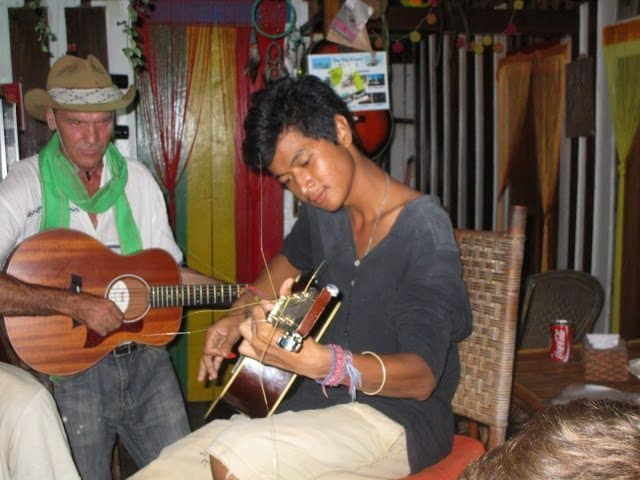 Natives playing music on the island in a public restaurant.