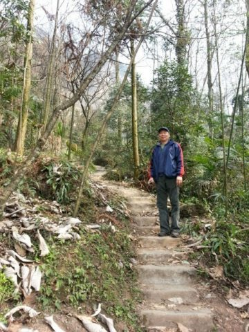 Cheng Wang on the pathway up the mountain.