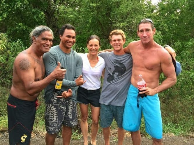 Noelle Salmi relaxes with Titus Kinimaka Kaimi Kaneholani Ry Cowan and Clay Wolcott after surfing at Pakalas Kauai HI. Photo by Suzie Black