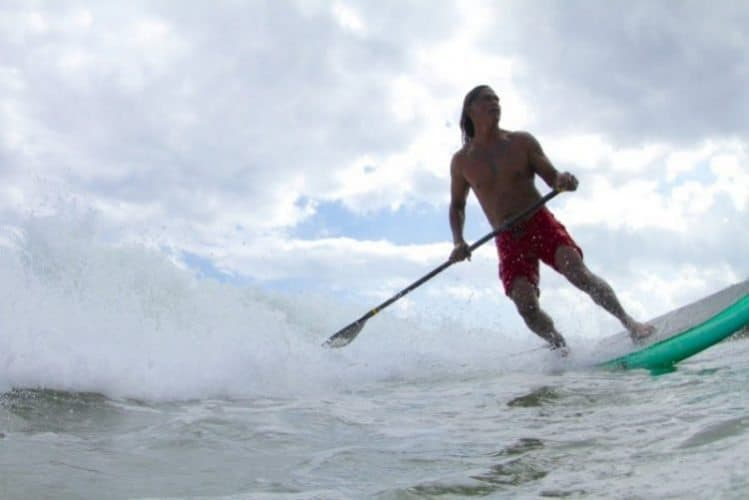 Titus Kinimaka in command of his stand up paddle at Hanalei Bay Kauai HI. Photo by Ry Cowan
