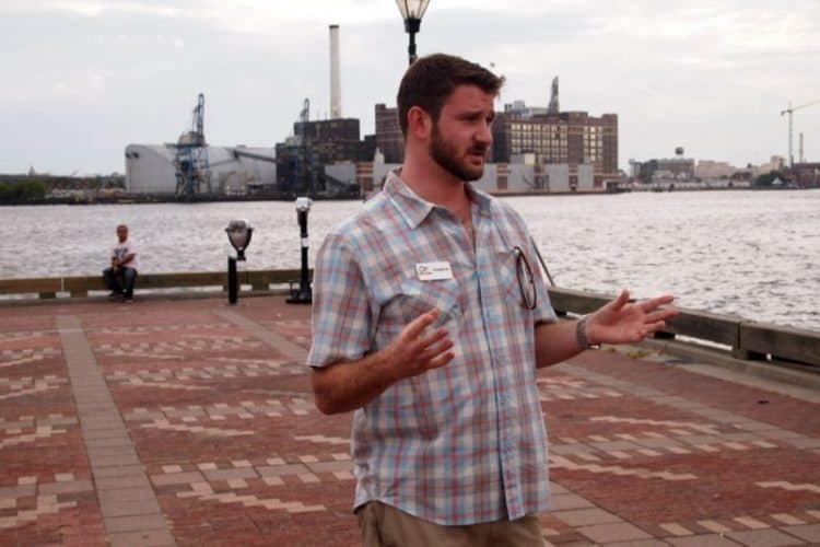 AJ Jensema, of Charm City Food Tours, shows off his city's food at Fells Point.