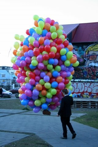 Man walks his cat in a basket of balloons in Reykjavik and no one bats an eye.