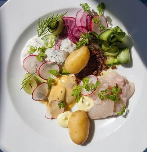Paven restaurant. Fish platter: selection of local small fishes, three different Baltic herrings, whitefish, new potatoes and gherkins.