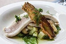 Ateljee Finne restaurant, Helsinki. Oven poached white fish with potato cucumber salad and cucumber vinaigrette.