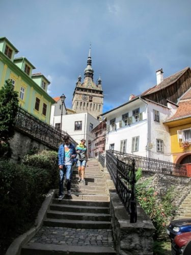 Steps leading from the new town to the citadel in Sighisoara, Romania. The citadel's Clock Tower, built in the 1400s, looms in the distance.