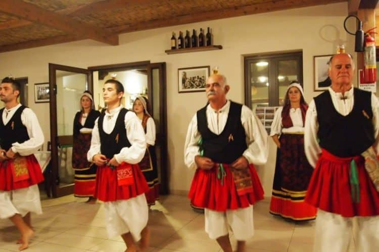 Local folk dancers demonstrate how they can dance with a glass of wine on their heads...and no one spilled!