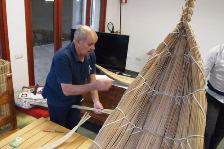 Fassonis are fishing boats made of woven reeds that were once used to fish for mullet in Cabras, Sardinia. Here a fisherman makes a small toy replica.