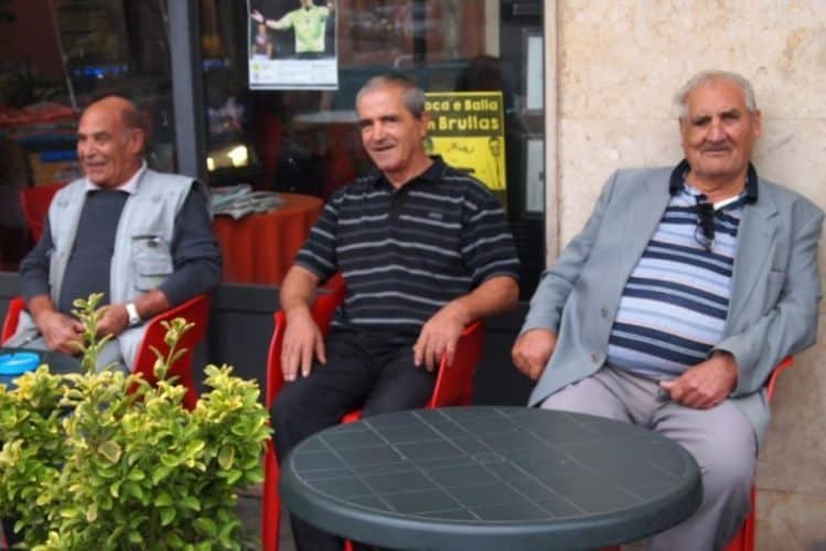 Men at a cafe in the morning in Cabras, Sardinia.