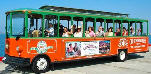 One way to discover the city is by trolley tour, photo credit Old Town Trolley Tours.