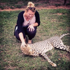Lottie Reeves with a cheetah in South Africa. Lottie Reeves photos.