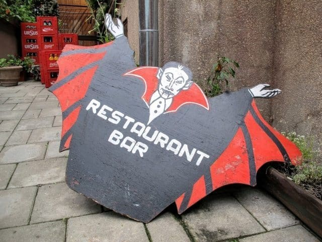 Though Dracula is an entirely fictional character imagined by an author who never set foot in Transylvania, the name and image are used for marketing everywhere in the region. This sign greets visitors to an outdoor cafe in Sighisoara.
