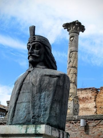 "This ominous-looking bust of Vlad ""The Impaler"" Tepes overlooks the ruins of his palace in the old town of Bucharest, Romania."