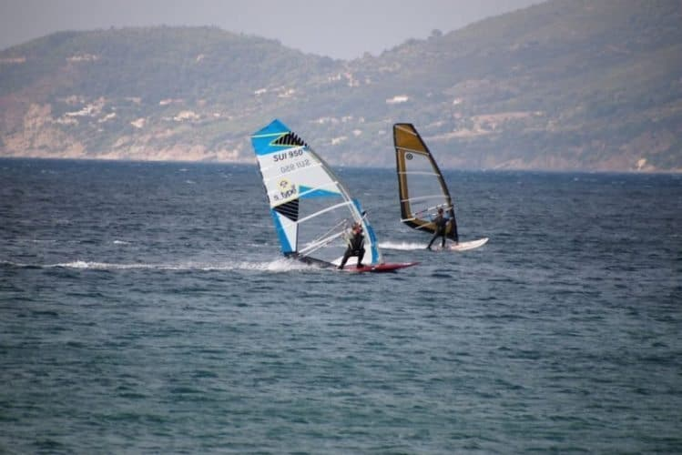 Windsurfers enjoy the strong winds of the double Tombolo, a two-headed peninsula off Hyeres, France.