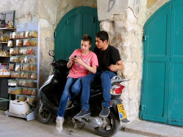 Teenagers on their cell phones in the Armenian Quarter.