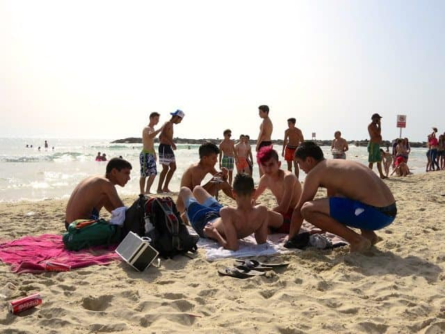 People gather at the beach in Tel Aviv.